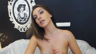 Young brunette plays with a dildo Thumbnail