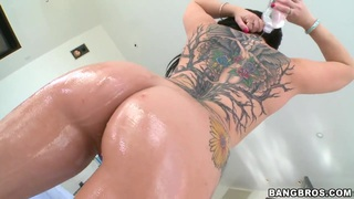 Casey Cumz oils her big butt and natural boobs and poses in front of the camera Thumbnail