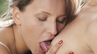 Two lovely babes pleasuring each others twats outdoors Thumbnail
