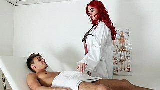 Redhead massages a big dick before sex